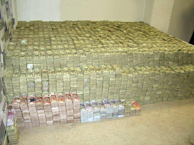 Cash Seized From a Drug Raid on a Dealer's Home