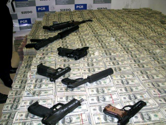 Cash and Weapons Seized From a Drug Raid on a Dealer's Home